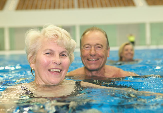 Active seniors in a pool